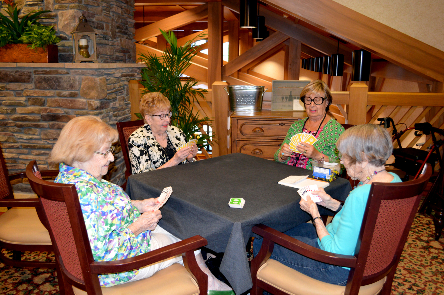Playing cards at Wiggins Place Senior Assisted Living Nursing Home Active Aging Menorah Park Beachwood Ohio