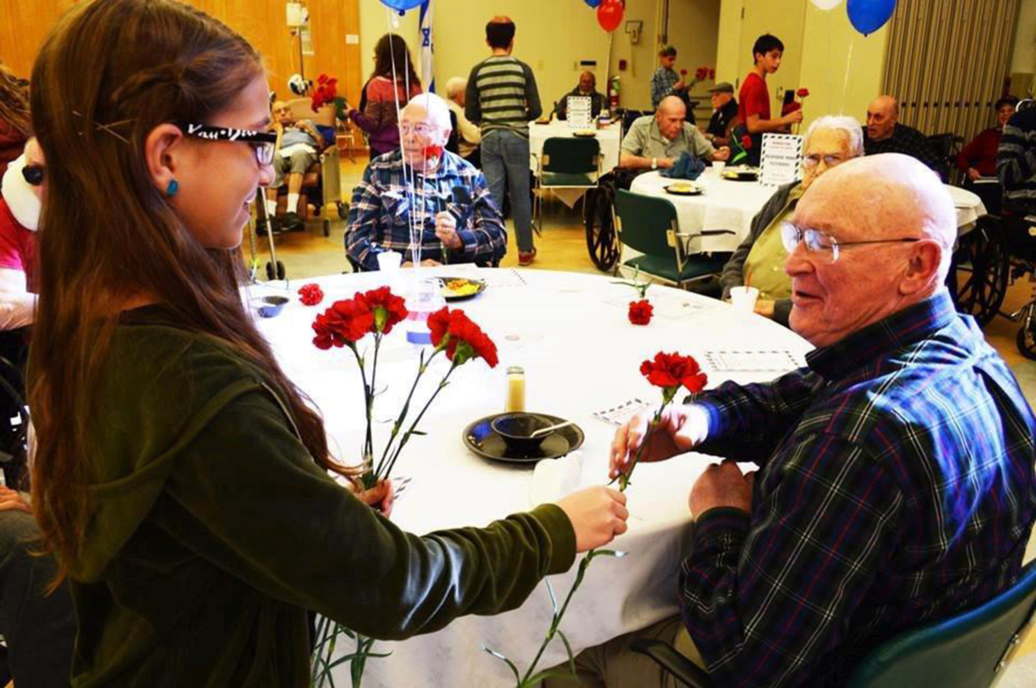 Menorah Park resident receives roses at assisted living skilled nursing care nursing home