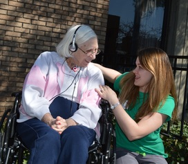 Donated iPods Bring Smiles & Comfort to Residents with Memory Loss